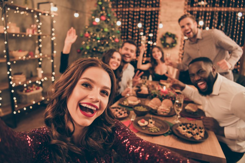 group of friends smiling at holiday party